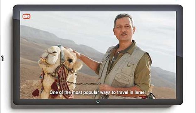 Hasbara campaign showing a foreign reporter with a camel
