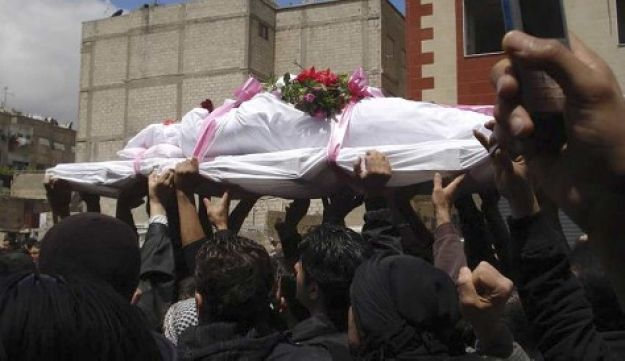 Funeral of anti-government protester - AP - April 23, 2011