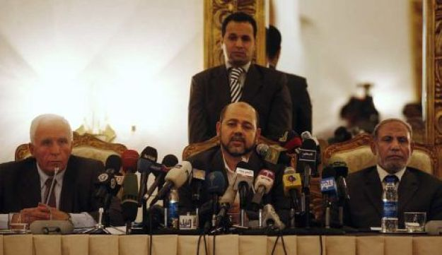 Zahar with Marzoug and Ahmed - AP - April 27, 2011