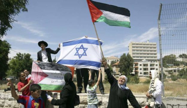 Israeli Arabs next to Israeli Jews in Jerusalem holding national flags to mark Israeli Indpendence Day and Palestinian Nakba Day respectively.