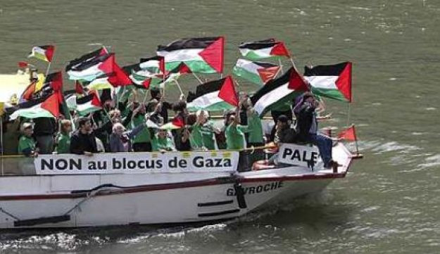 Pro-Palestinian activists demonstrating ahead of expected arrival of a Freedom flotilla in Gaza.