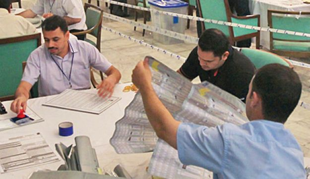Workers counting ballots in Baghdad
