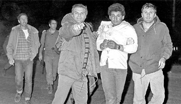 Majdi Abu Jumma, a suspect in the 1984 Bus 300 hijacking, being led to his death by Shin Bet men