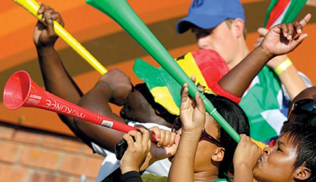 Fans blow vuvuzelas at the 2010 FIFA World Cup in South Africa
