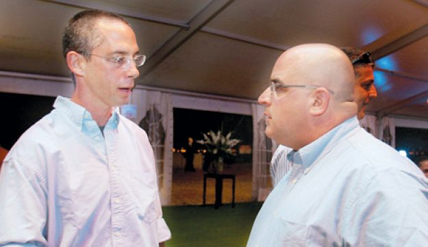 Former PM Ariel Sharon's sons Gilad, left, and Omri.