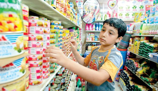 Gazan boy shopping
