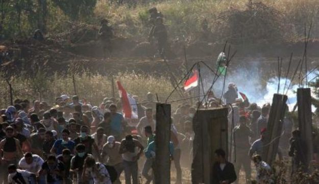 Protesters run from Syrian border - Reuters - June 5, 2011