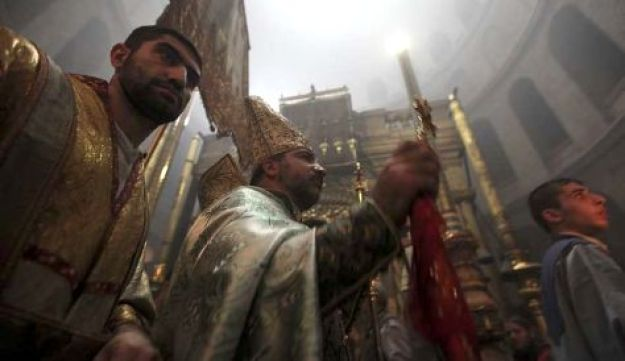 An Armenian  priest processes at the Church of the Holy Sepulcher in Jerusalem.