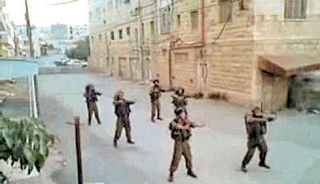 Screen grabs from the YouTube video clip of IDF soldiers performing a choreographed routine while on