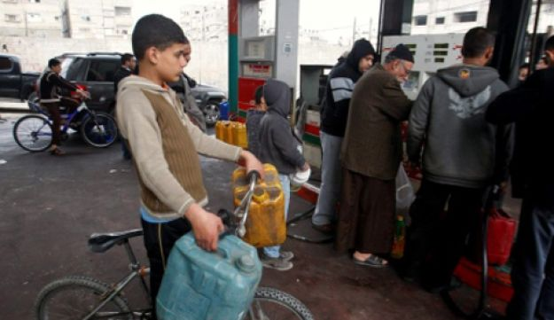 Palestinians in Gaza stocking up on fuel.