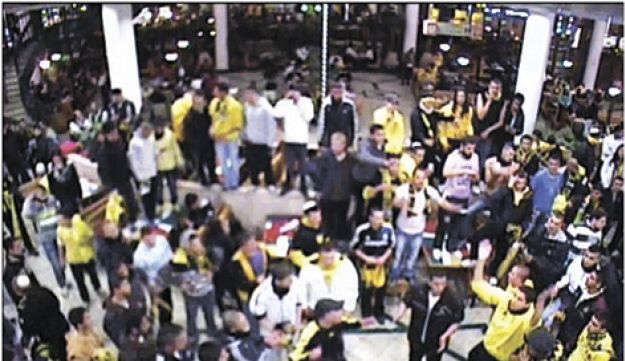 Beitar fans captured on security camera at the Malha shopping mall.