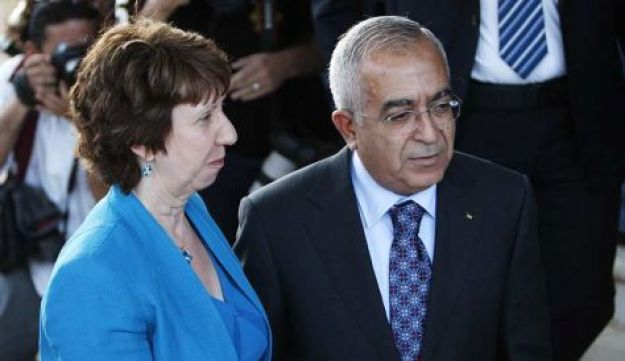 Palestinian Prime Minister Salam Fayyad greets EU's High Representative for Foreign Affairs and Secu