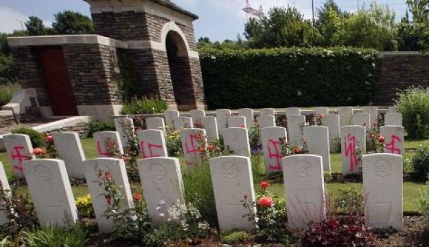 A gravestones desecrated with swastika, seen at the British World War I cemetery in Loos-en-Gohelle,