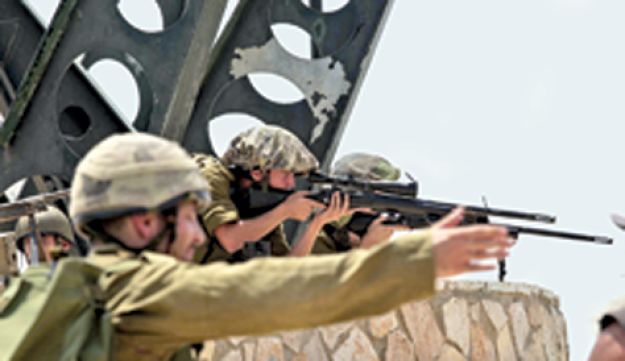 IDF soldiers taking positions against Lebanese forces at Kibbutz Misgav Am on Israel's northern border, August 2010.