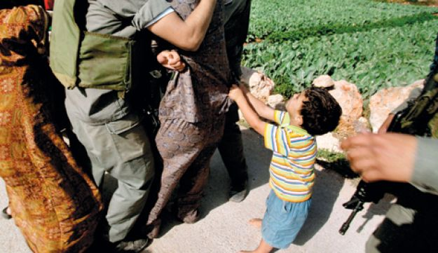 Palestinian boy upset by his father's arrest