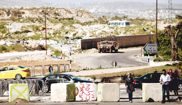 The entrance to A-Ram northeast of Jerusalem, which has been blocked by the military.