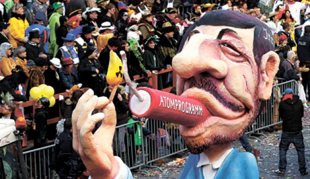 A float depicting Iranian President Ahmadinejad in Germany two weeks ago.