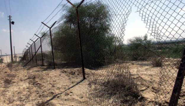 Fence marking border between Egypt and Israel.