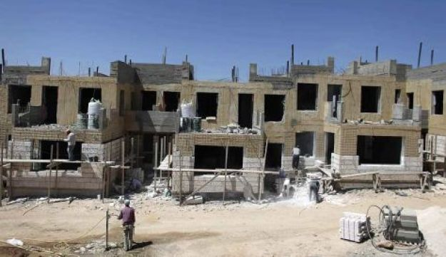 Palestinians work at a construction site in the West Bank Jewish settlement  of Elazar, near Bethleh