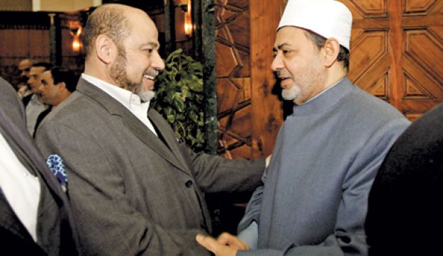 Moussa Abu Marzouk, left, shaking hands with the imam of Cairo's Al-Azhar Mosque.