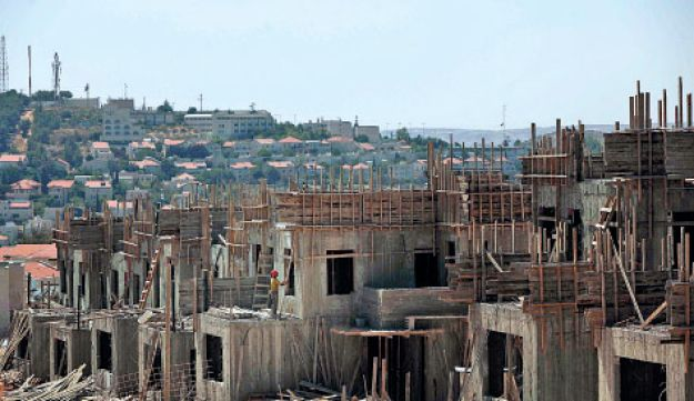 Construction work in Elazar, a settlement in the Gush Etzion bloc, in July 2010.