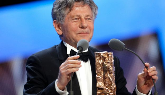 Director Roman Polanski reacts after winning the Best Director award  February 25, 2011.