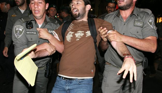 Israel Border Police arrest a protester on May 8, 2012.