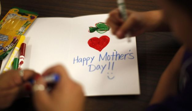 Children draw Mother's Day cards May 2012.