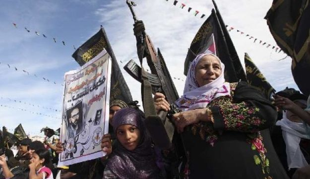 palestinian woman grandmother with gun islamic jihad rally Reuters Oct 29, 2010