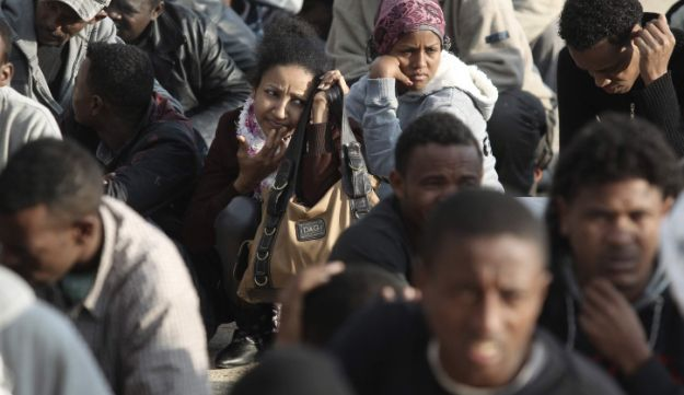 Migrants from Africa waiting on line to register as asylum seekers.