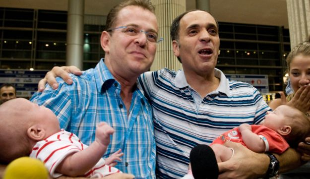 Dan and Arnon Goldberg returning with their newborn twins born via a surrogate mother in India.