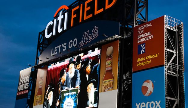 Rabbi talks about the dangers of internet use on the giant screen at Citi Field Stadium.
