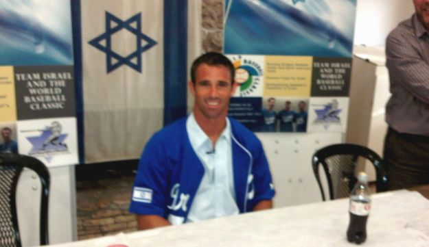 Ausmus wearing the blue and white Israel jersey.