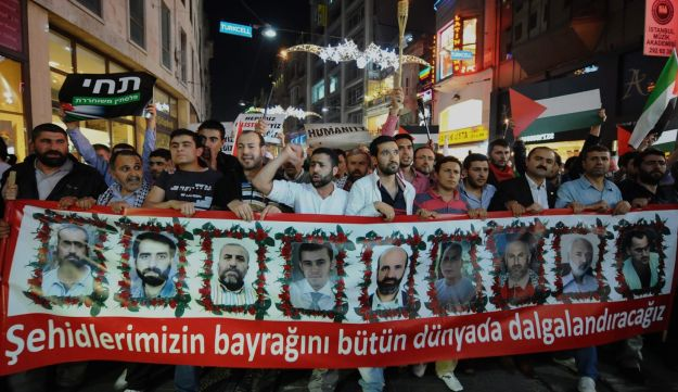 Turkish activists with pictures of victims of the raid on the Gaza-bound flotilla.