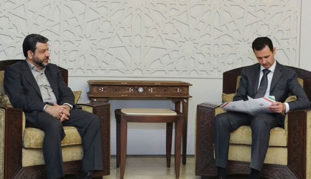 Syria's President Bashar Assad (R) meets Iran's Minister of Information and Communication.