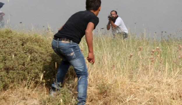 Palestinian settlers clash - AP - May 19, 2012