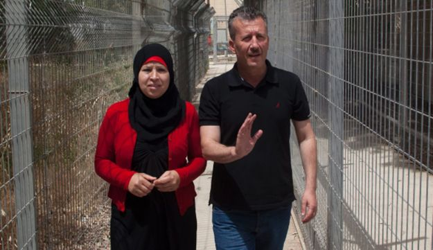 Palestinian activist Bassem Tamimi and his wife near the West Bank city of Ramallah, May 29, 2012.