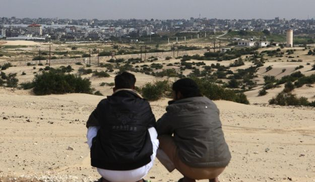 Bedouins squat over a hilly area overlooking Gaza, in Rafah city, north Sinai, in March, 2012.