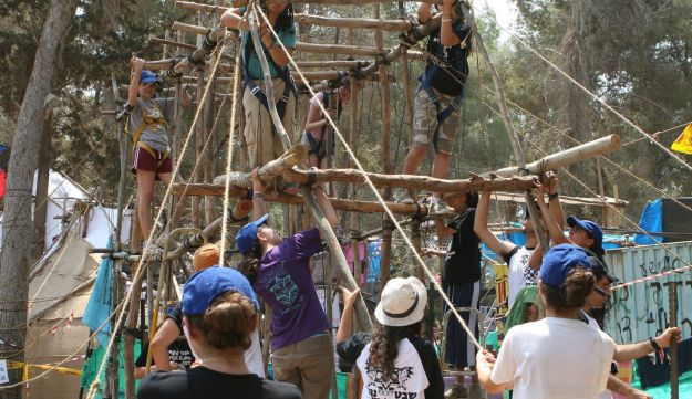 Children in Israel participate in an activity at a scout  summer camp.