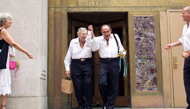 Myron Levine (center, L) and Philip Zinderman celebrate after being married.