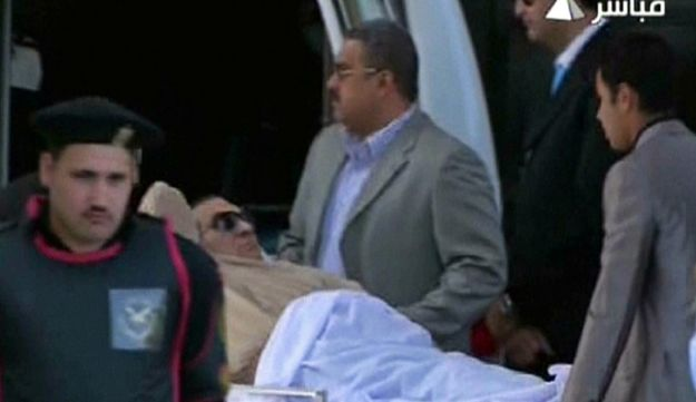 An image grab taken from Egyptian state TV shows ex-Egyptian president Mubarak arriving at court.