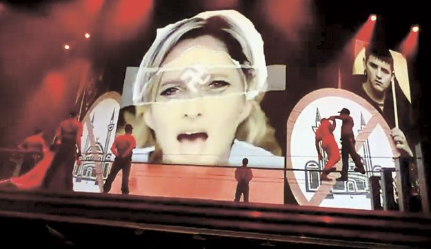 The image of Marine Le Pen with a swastika on her forehead that was screened during concert.