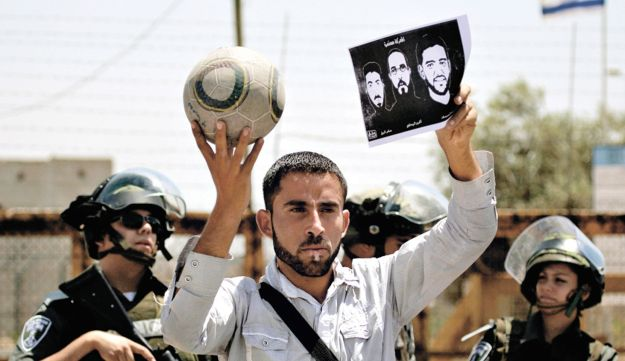 A Palestinian man demonstrating outside the Ofer military prison earlier this week.
