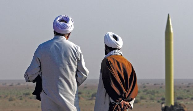 Men watching the launch of a Shahab-3 missile near Kom
