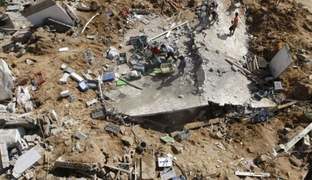 The rubble of a building hit in an overnight Israeli air strike in Gaza City, June 4, 2012.