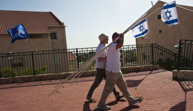 Men in Ulpana, on the edge of the West Bank Jewish settlement of Beit El.