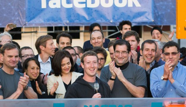 Facebook CEO Mark Zuckerberg, center, rings the Nasdaq opening bell from Facebook headquarters in Me