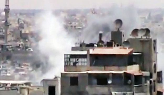 An image made from amateur video, released by the Shaam News Network, purporting to show smoke risin