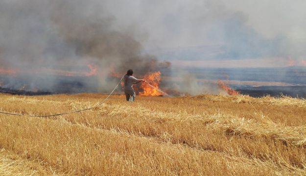 A fire that erupted after a rocket exploded in southern Israel - Hershkovitz