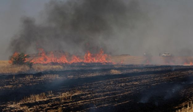 A fire that erupted in southern Israel following a rocket attack launched from Gaza, June 19, 2012.